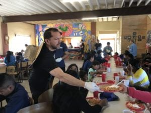 Chatmeter hands out breakfast at a Children's church group in Mexico