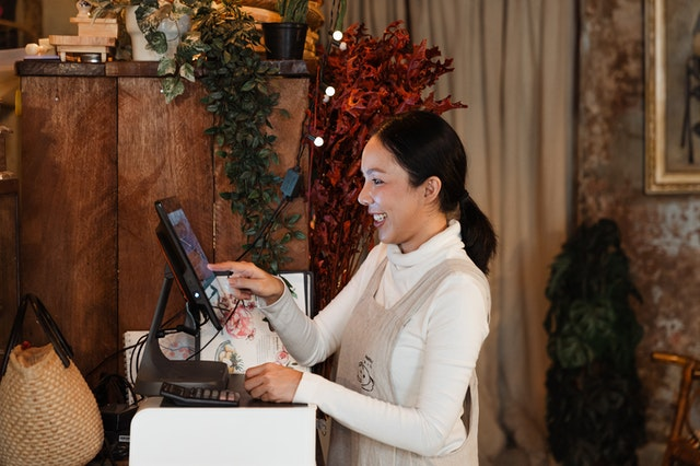 Employee at register of small business